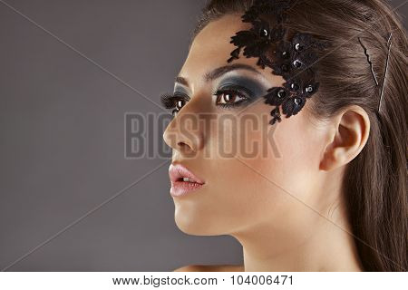 Beautiful Girl With Decoration On The Face, In Profile