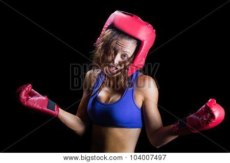 Portrait of crazy fighter with arms outstretched against black background