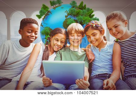 Happy children using digital tablet at park against earth floating in room