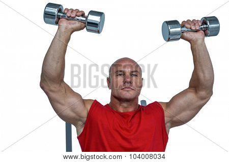 Athlete lifting dumbbells against white background