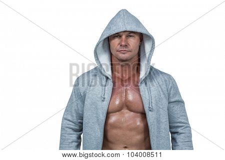 Portrait of macho man in hood against white background