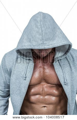 Muscular man in grey hood against white background