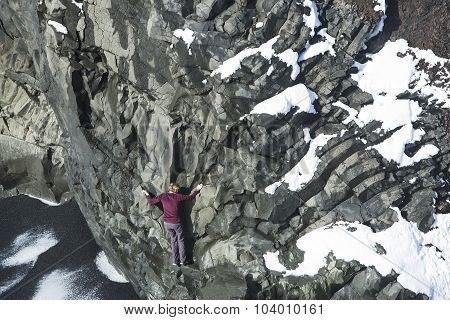 Woman Climbing Up Basalt Rocks, Iceland
