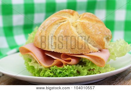 Ham roll with lettuce, closeup