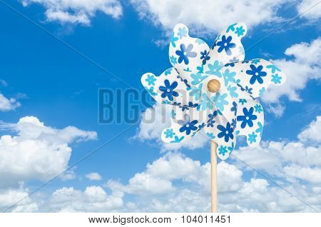 Colorful Pinwheel On Blue Sky Background