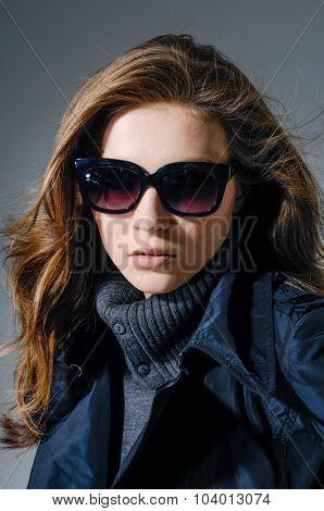 portrait of fashion model-gray background