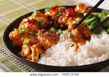 General Tso's Chicken With Rice For Dinner. Horizontal Close-up