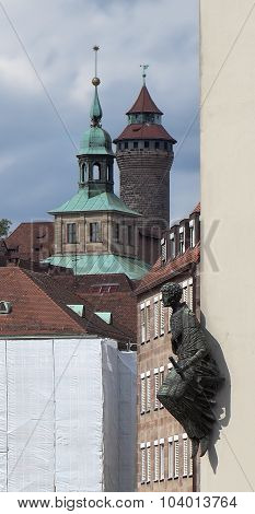 The historic center of Nuremberg. Spital-Apotheke and a monument to one of the founders.