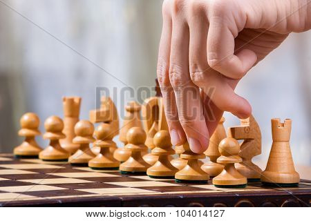 Hand Of Chess Player With Pawn