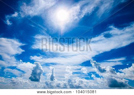 Beautiful Cloudscape With Sun And Fluffy Clouds On Blue Sky.