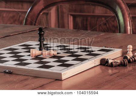 Chess Tactics Concept With Chess Game And Pawns On Wooden Table.