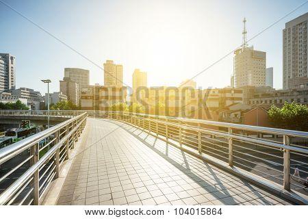 pedestrian overcrossing in the city center under sunset