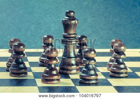 Teamwork Concept With Chess Pawns Around Chess Queen.