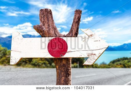 Japan Flag wooden sign with road background