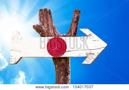 Japan Flag wooden sign with sky background