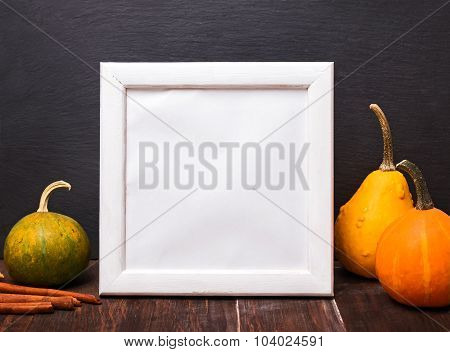Decorative Pumpkins And Empty White Frame.