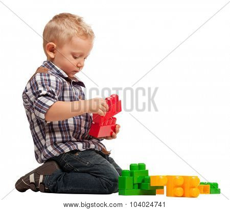 child play with construction toy blocks isolated on white