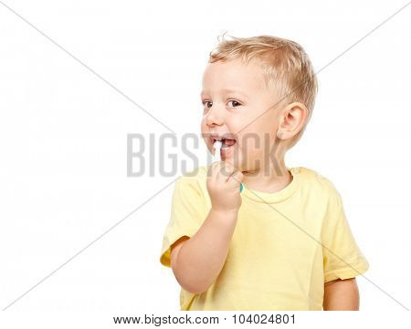 child brushing teeth isolated on white background