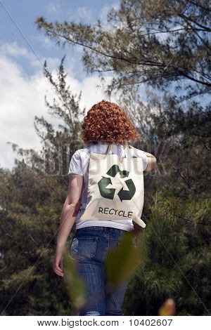 Woman With Recycling Bad In Nature