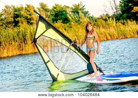 Little Girl Winsurfing On Ada Bojana, Montenegro