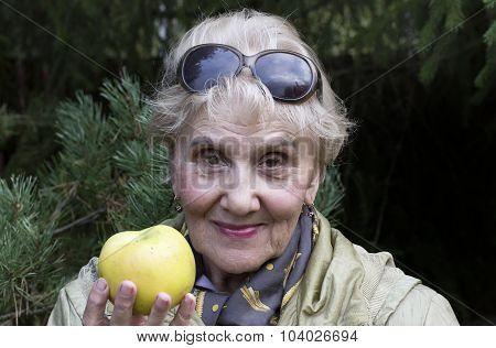 Senior Female With Apple
