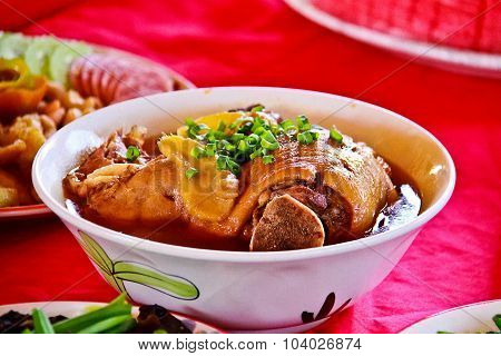 Stewed Pork Pork Inside Big Cup On The Red Table,is A Favorite For  The Chinese People.