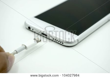 Close Up Image Of The New Apple Iphone 6S With The Charging Cabl