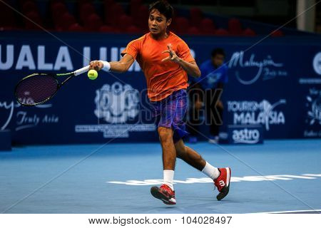 KUALA LUMPUR, MALAYSIA - SEPTEMBER 27, 2015: Ahmed Deedat of Malaysia plays in his qualifying match at the Malaysian Open 2015 Tennis tournament held at the Putra Stadium, Malaysia.