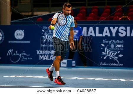 KUALA LUMPUR, MALAYSIA - SEPTEMBER 27, 2015: Michal Przysiezny of Poland plays in his qualifying match at the Malaysian Open 2015 Tennis tournament held at the Putra Stadium, Malaysia.