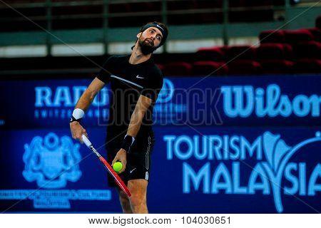 KUALA LUMPUR, MALAYSIA - SEPTEMBER 30, 2015: Nikoloz Basilashvili from Georgia serves in his match at the Malaysian Open 2015 Tennis tournament held at the Putra Stadium, Malaysia.
