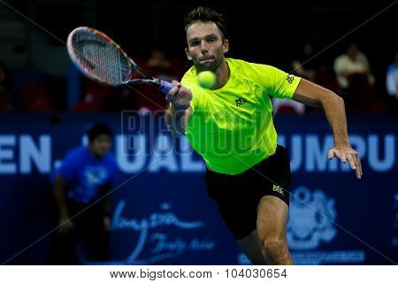 KUALA LUMPUR, MALAYSIA - SEPTEMBER 30, 2015: Ivo Karlovic of Croatia hits a forehand return in his match at the Malaysian Open 2015 Tennis tournament held at the Putra Stadium, Malaysia.