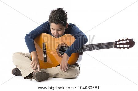 Child guitarist resting isolated on  white background.