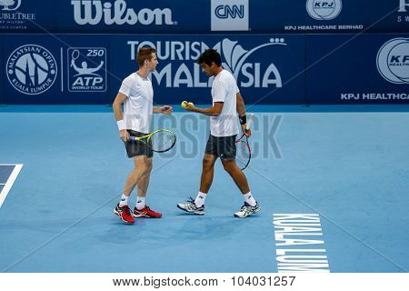 KUALA LUMPUR, MALAYSIA - SEPTEMBER 30, 2015: Jonathan Marray (left) and Rameez Junaid (right) reacts after a point their match at the Malaysian Open 2015 tennis tournament held at the Putra Stadium.