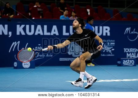 KUALA LUMPUR, MALAYSIA - SEPTEMBER 30, 2015: Nikoloz Basilashvili from Georgia makes a return in his match at the Malaysian Open 2015 Tennis tournament held at the Putra Stadium, Malaysia.