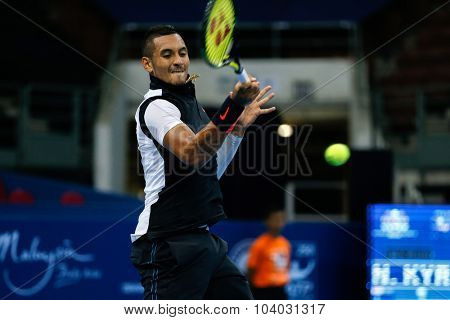 KUALA LUMPUR, MALAYSIA - SEPTEMBER 30, 2015: Nick Kyrgios of Australia hits a forehand return in his match at the Malaysian Open 2015 Tennis tournament held at the Putra Stadium, Malaysia.