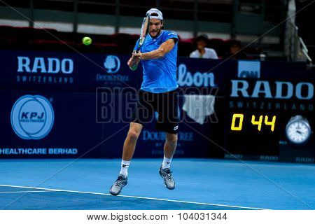 KUALA LUMPUR, MALAYSIA - SEPTEMBER 30, 2015: Joao Sousa of Portugal hits a backhand return in his match at the Malaysian Open 2015 Tennis tournament held at the Putra Stadium, Malaysia.