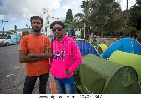 KOS, GREECE - SEP 27, 2015: Unidentified refugees. More than half are migrants from Syria, but there are refugees from other countries - Afghanistan, Pakistan, Iraq, Iran, Mali, Bangladesh, Eritrea