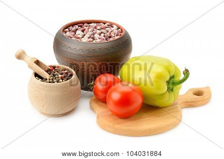 beans in pot and vegetables isolated on white