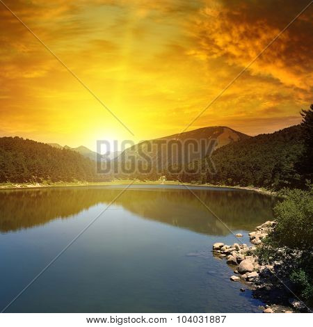 sunrise over lake and mountains