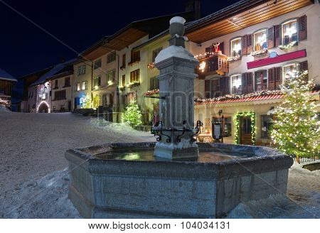 Frozen Fountain In The Street Of Gruyere