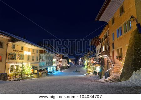 Picturesque Winter Night View Of The Medieval Town Of Gruyeres