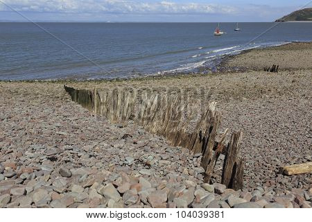 Old Worn Breakers On A Beach At Porlock