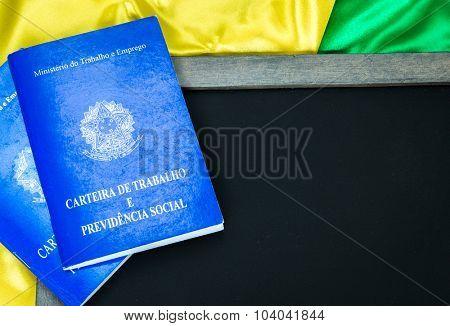 Brazilian work document and social security document (Portuguese: Carteira de Trabalho) on brazilian flag