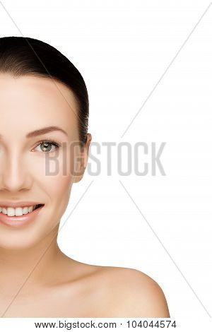 Half Face Of Beautiful Young Brunette Woman With Clean Fresh Skin With Nude Makeup Looking Straight