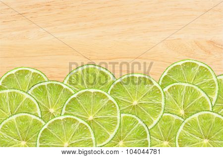 Fresh Lime Slices On Wooden Table Background