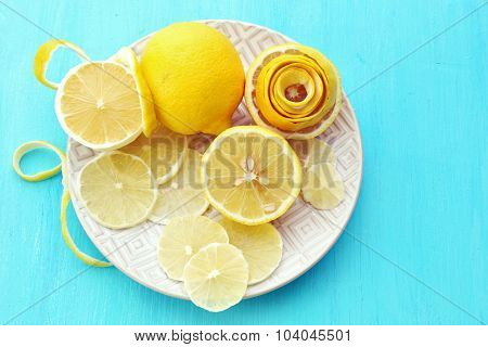 Ripe lemons on wooden table close up