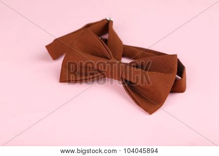 Brown Bow Tie On A Pink Background