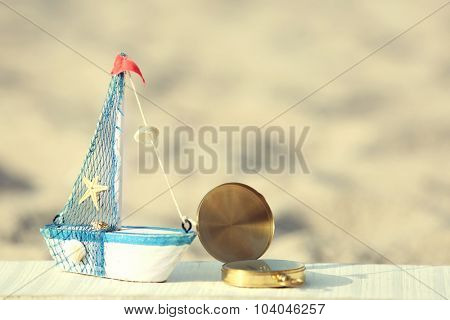 Beautiful sea composition with ship on sand beach background