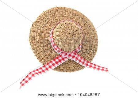 wicker summer hat with red checkered ribbon