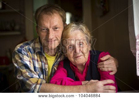 Portrait of a grandmother and her adult grandson.